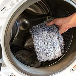 Dusting pad being placed into washing machine