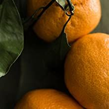 THE ESSENCE of mandarin and bergamot add a spark of crisp citrus to this warm and wooded aroma.